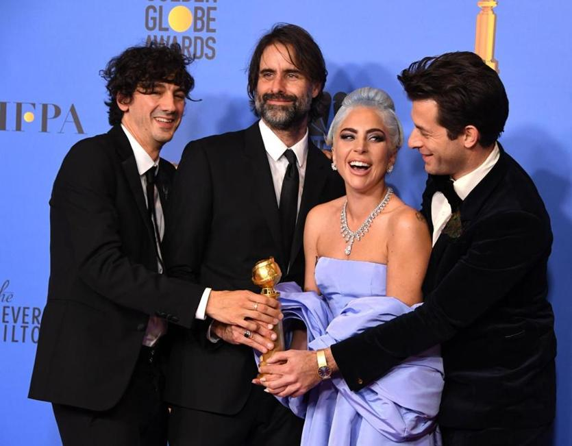 "Winners for Best Original Song - Motion Picture for ""Shallow - A Star is Born"" (R-L) Mark Ronson, Lady Gaga, Andrew Wyatt and Anthony Rossomando pose with the trophy during the 76th annual Golden Globe Awards on January 6, 2019, at the Beverly Hilton hotel in Beverly Hills, California. (Photo by Mark RALSTON / AFP)MARK RALSTON/AFP/Getty Images"