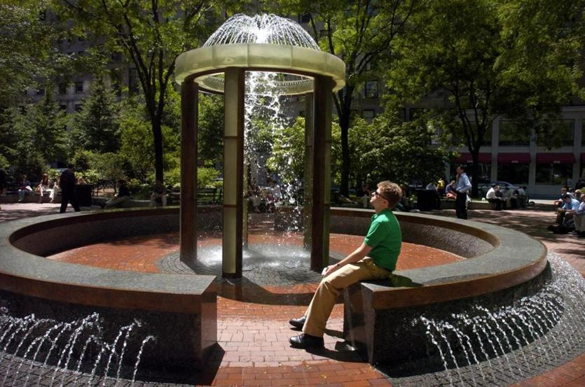 Boston...6/4/04...Jason Grout, who works in the area, enjoys the sun and water in the park in Post Office Square. Library Tag 07252004 Boston Insider