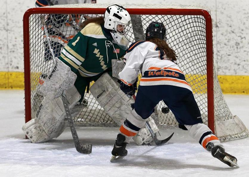 Walpole's Meghan Hamilton beats Matignon goalie Dana Smullen in the first period to put Walpole ahead, 2-0.