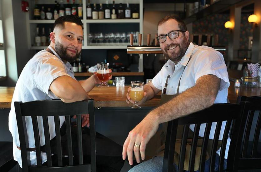 Newton, Ma., 04/24/2019, Chef Francisco Millan, left, and owner Dave Punch of The Buttonwood Restaurant which has re-opened after a fire shut it down for five months. Suzanne Kreiter/Globe Staff