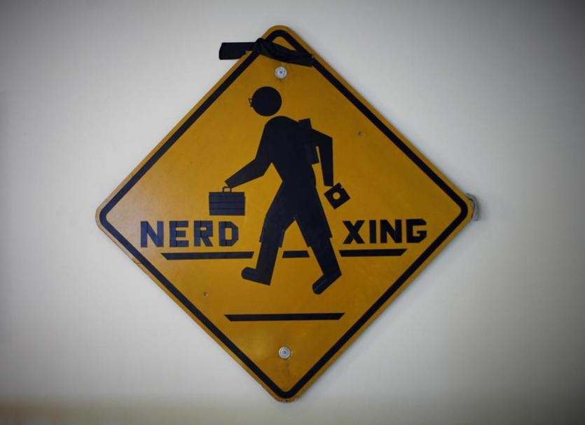 "Some hacks bemoan the school's culture while others celebrate it. This ""Nerd Xing"" sign, now on display in the Hall of Hacks, was put up on MIT's campus in 1987."