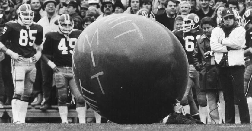 In perhaps the best-known prank in MIT history, members of MIT's Delta Kappa Epsilon fraternity planted an MIT balloon under the grass at Harvard Stadium and launched it during the 1982 Harvard-Yale football game.