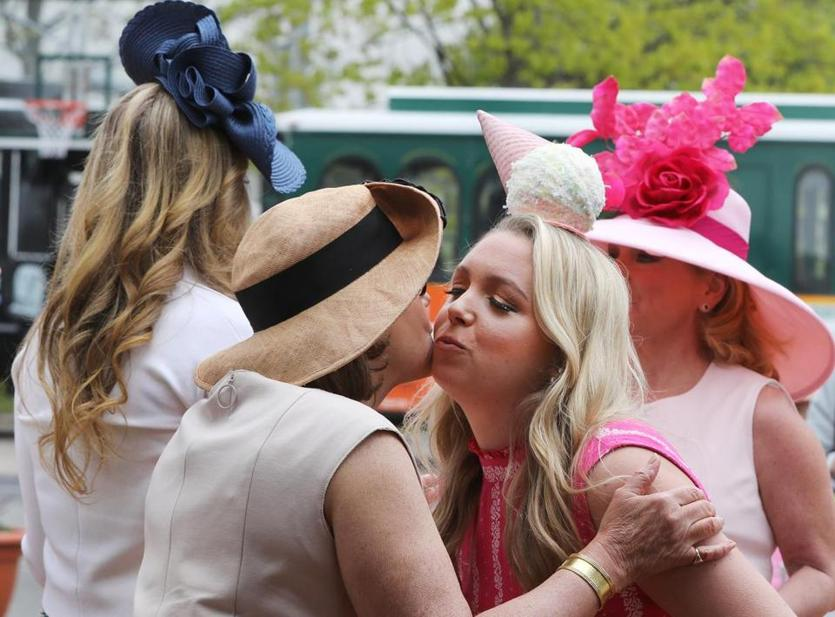 Boston, MA - 5/15/19 Sarah Dale (cq), center, Boston, is greeted by co-chair Holly Safford (cq), left. Lynn Dale (cq), mom, is at right. The annual Party in the Park fundraiser is held in Franklin Park. Photo by Pat Greenhouse/Globe Staff Topic: 16namesHats