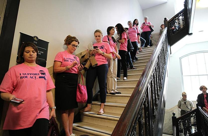 Boston, MA., 06/17/2019, Suporters of the the Roe Act (pro-choice) line a staircase waiting to attend a hearing on the matter. Suzanne Kreiter/Globe Staff