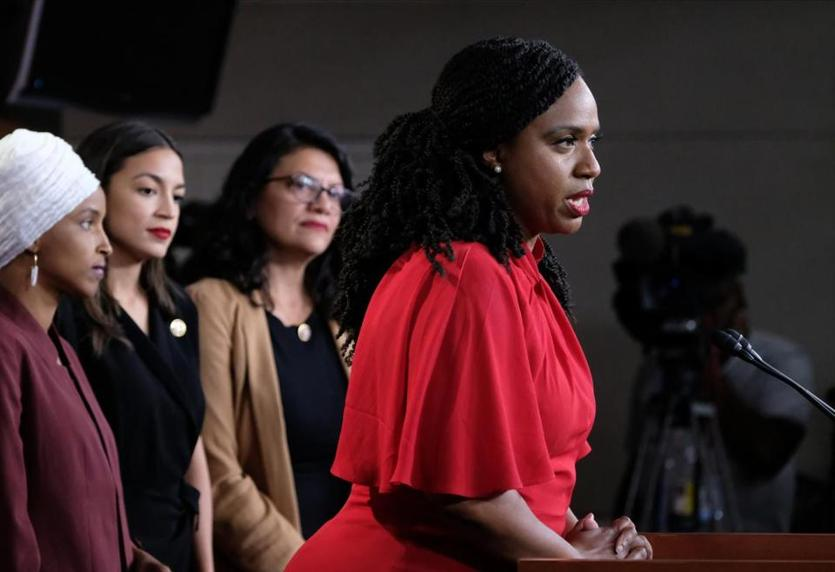 "WASHINGTON, DC - JULY 15: U.S. Rep. Ayanna Pressley (D-MA), speaks while Reps. Ilhan Omar (D-MN), Alexandria Ocasio-Cortez (D-NY), and Rashida Tlaib (D-MI) listen during a press conference at the U.S. Capitol on July 15, 2019 in Washington, DC. President Donald Trump stepped up his attacks on four progressive Democratic congresswomen, saying if they're not happy in the United States ""they can leave."" (Photo by Alex Wroblewski/Getty Images)"