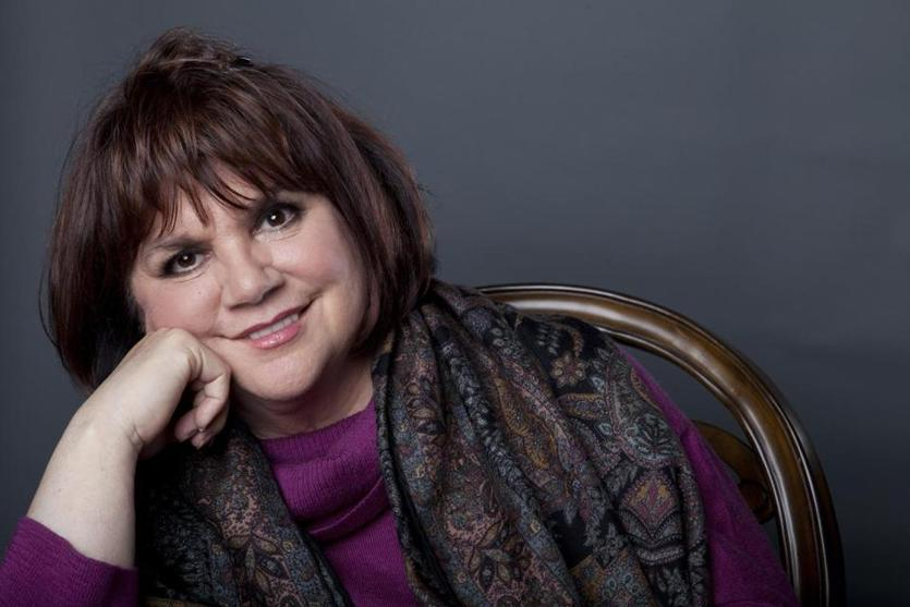 FILE - In this Sept. 17, 2013 file photo, American musician Linda Ronstadt poses in New York. Iconic actress Sally Field and foundational children's show Sesame Street top this year's class of Kennedy Center Honors recipients. Other chosen to receive the award for lifetime achievement in the arts include singer Linda Ronstadt, conductor Michael Tilson Thomas and the R&B group Earth, Wind and Fire.(Photo by Amy Sussman/Invision/AP, File)
