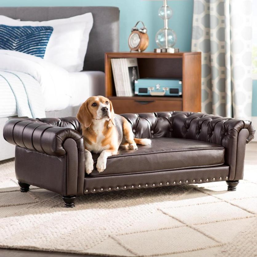 The Archie & Oscar faux leather Cornelia Dog Sofa ($399.99) is made to hold up to 80-pound dogs. MUST CREDIT: Wayfair