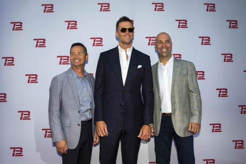 Boston, MA - 9/17/2019 - From left, TB12 Co-Founder Alex Guerrero, Tom Brady and TB12 CEO John Burns pose during the TB12 Grand Opening Event at the TB12 Performance & Recovery Center in Boston, Mass. on Tuesday, Sept. 17. (Nic Antaya for The Boston Globe) Topic: 18TB12photos