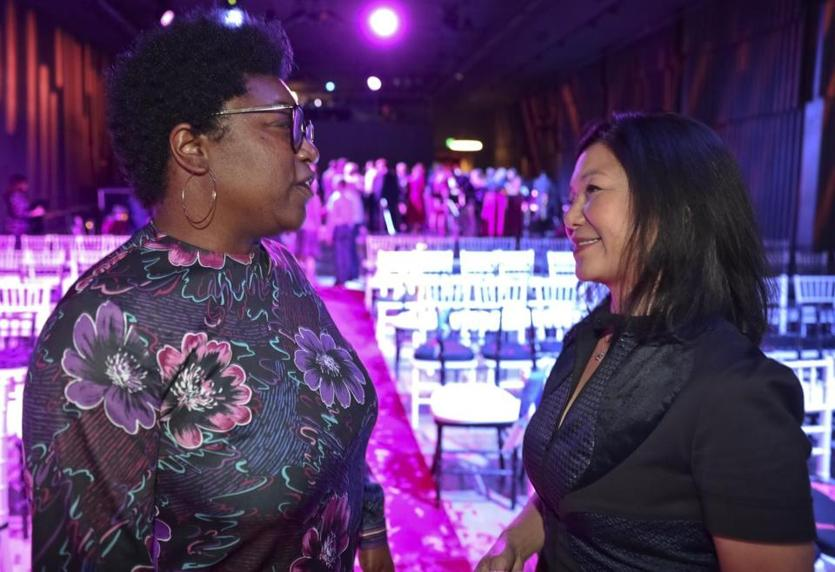 "Boston MA 10/15/19 Deesha Dyer (left) served as the White House Social Secretary for U.S. President Barack Obama from 2015 to 2017 talking to Janet Wu (WHDH) during event planner Bryan Rafanelli party celebrating the release of his book, ""A Great Party,"" at the Revere Hotel. (photo by Matthew J. Lee/Globe staff) topic: 16Rafanelliparty reporter:"