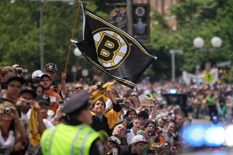 Hundreds of thousands of fans turned out for a parade honoring the Bruins' Stanley Cup triumph.