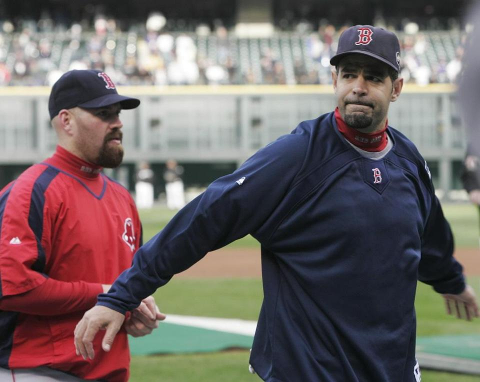 Mike Lowell, right, had four RBI in the World Series, including a home run in the series-clinching win.