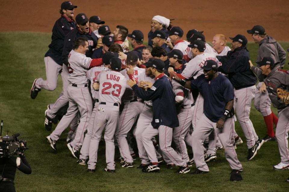 The Red Sox poured onto the field to celebrate their second World Series title in four years.
