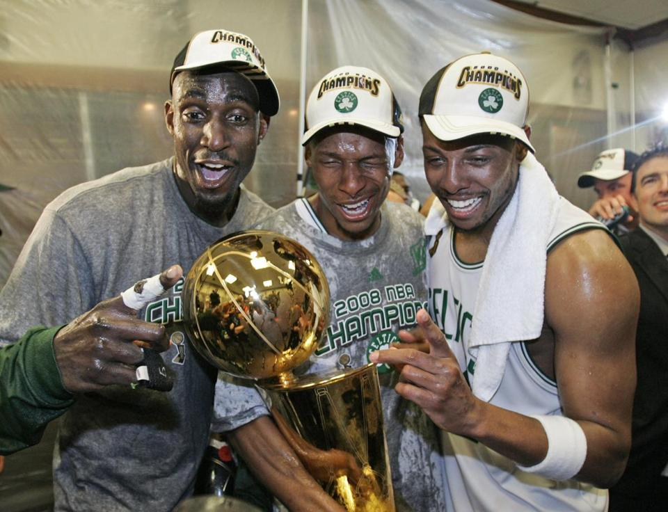 Kevin Garnett, Ray Allen and Paul Pierce, left to right, celebrate after winning the NBA title in six games against the Lakers.
