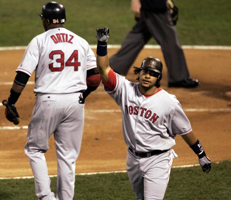 Manny Ramirez celebrates a first-inning home run in the Red Sox' victory in Game 3.