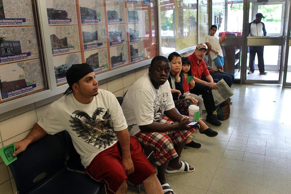 The Boston Public Schools' East Zone Family Resource Center in Dorchester was packed in early September with families trying to get a school assignment, months after the lottery and days before the start of school.