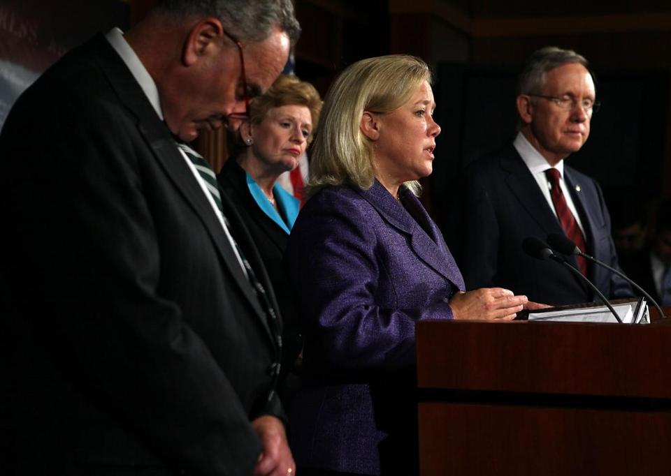 Senator Mary Landrieu spoke to reporters as colleagues Charles Schumer (left), Debbie Stabenow, and Harry Reid listened.
