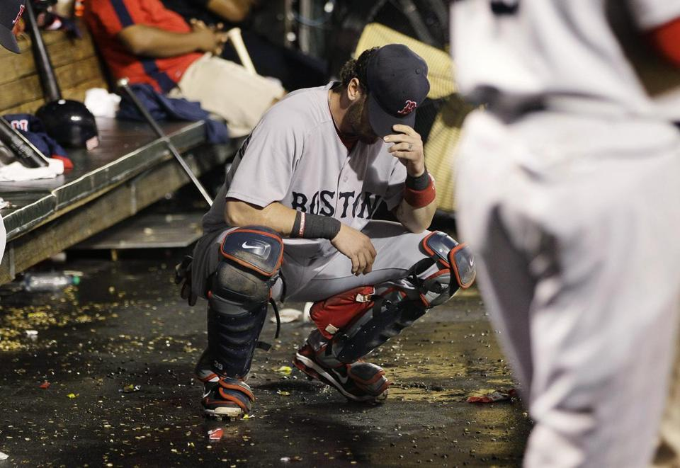Jarrod Saltalamacchia hung his head in the dugout during the Red Sox' ninth-inning meltdown last night.