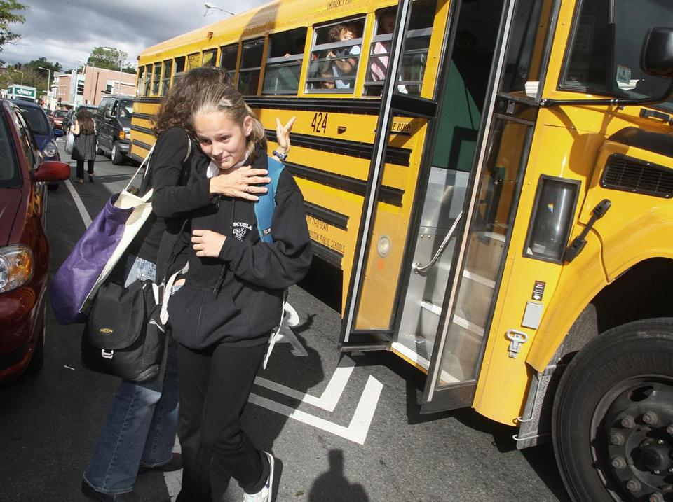 "Megan Wol f— shown greeting her daughter Shaina, 12, at the Jamaica Plain stop yesterday — calls the problem of late-running school buses ""terrible."""