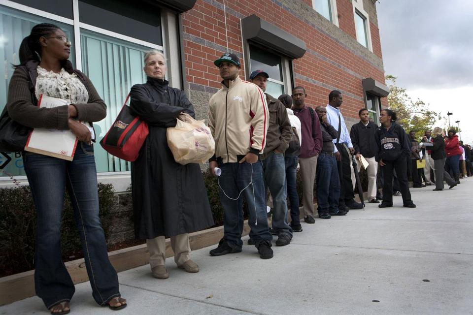 People waited in line at an employment fair held in Boston last October.