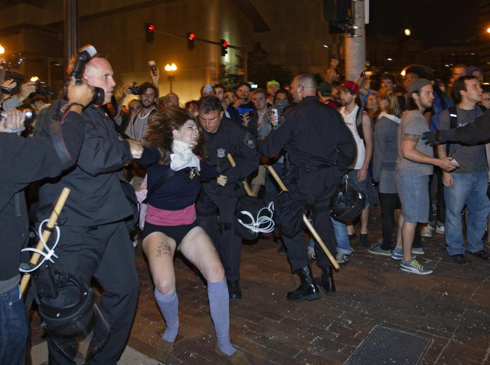 About 100 people were arrested, Commissioner Edward F. Davis said.  According to police, no protesters or police were injured.