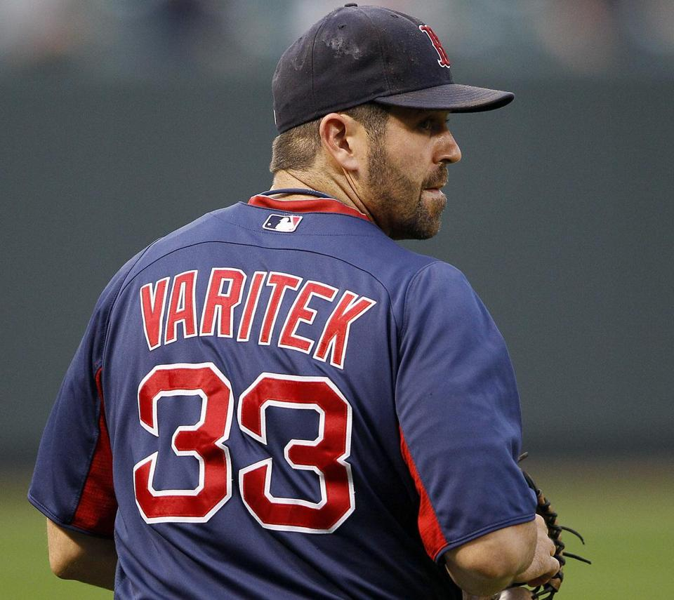 Boston Red Sox catcher Jason Varitek looks back toward the infield as he walks onto the field before the Red Sox's baseball game against the Baltimore Orioles on Tuesday, Sept. 27, 2011, in Baltimore. Varitek is recovering from a sore knee. (AP Photo/Patrick Semansky)