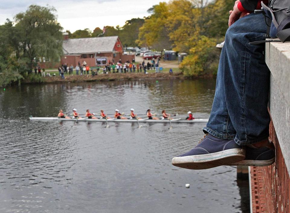 There will be plenty to see from the many vantage points on the foot bridge — including this one at the Eliot Bridge — in racing in the Head of the Charles Regatta Saturday and Sunday.