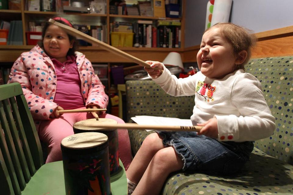 Patients Helen German (left), 9, of Lawrence, and Avalanna Routh, 5, of Merrimac, enjoy a music therapy session at Dana-Farber Cancer Institute.