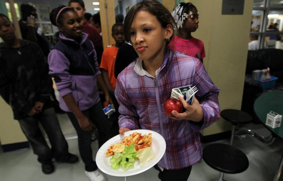 Karenny Mendez got dinner yesterday at the Boys and Girls Club of Boston's Kids Cafe at the Yawkey Club of Roxbury. A study sponsored by the Boston Foundation identifies Roxbury, along with Mattapan and Dorchester, as sections of Boston where poverty has deepened since the 1990s.