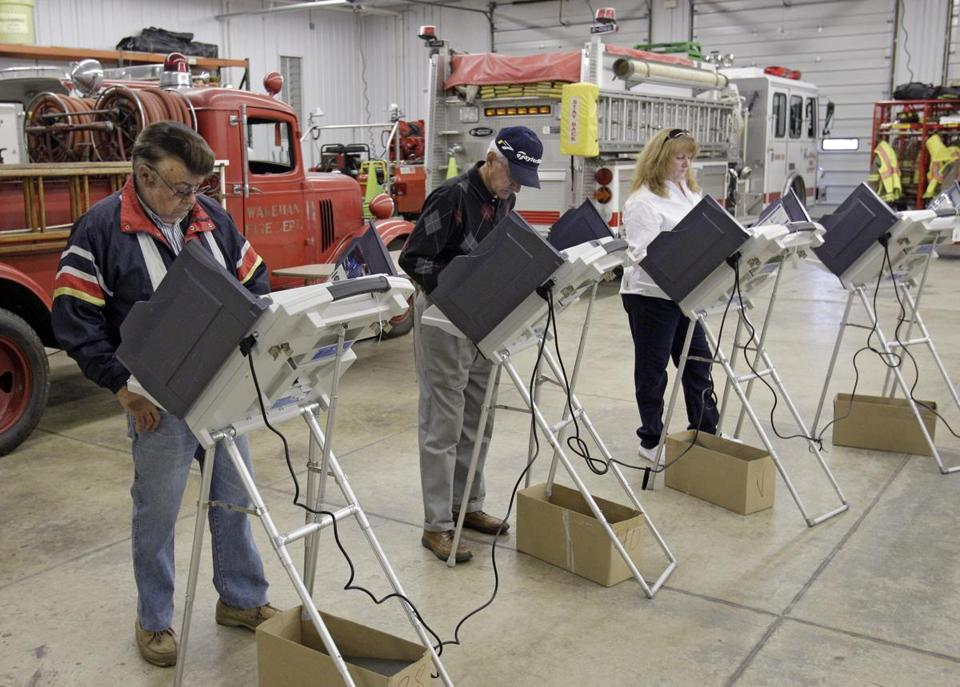 Voters cast their ballots at the Wakeman Township fire station near Wakeman, Ohio Tuesday, Nov. 8, 2011. Ohioans are deciding the winner of this year's drawn-out fight over a law limiting collective bargaining for 350,000 unionized public workers. The issue tops the Election Day list of ballot questions before the state's voters. (AP Photo/Mark Duncan)