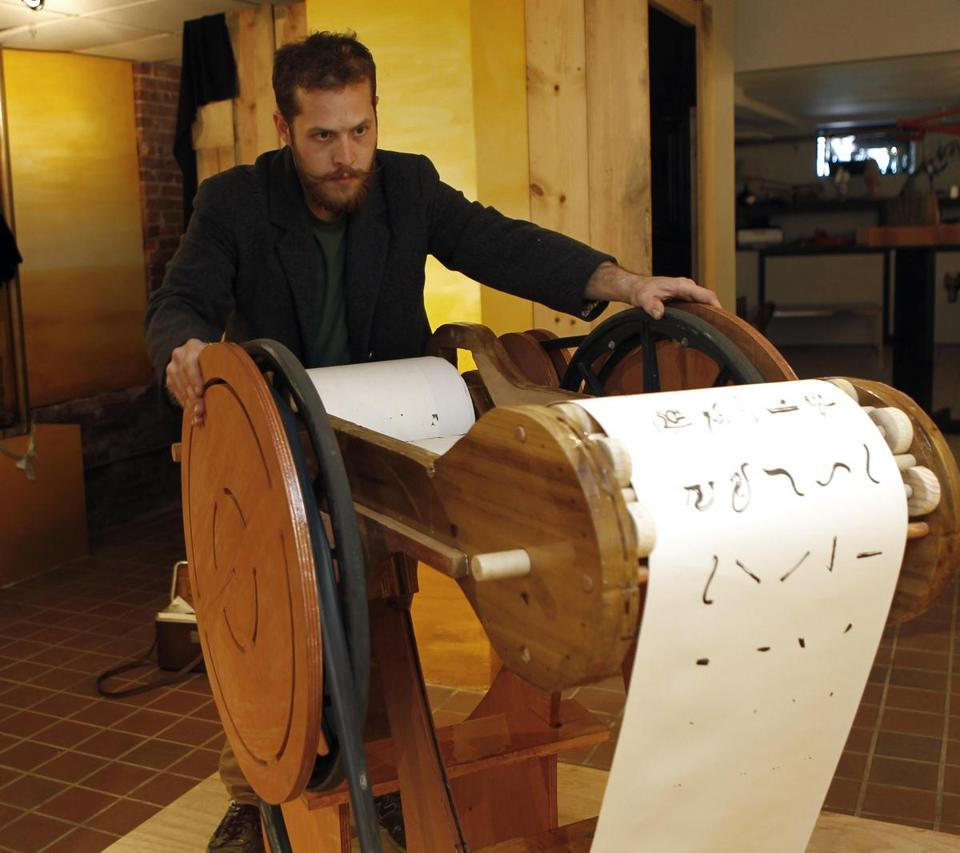 "Adrian Molina with his piece ""Emittime,'' which is a scroll of different scenes that he painted."