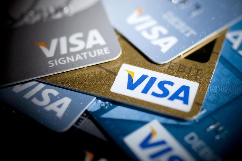 Visa, MasterCard, and other firms agreed in July to settle a lawsuit by retailers. A judge gave his preliminary approval.