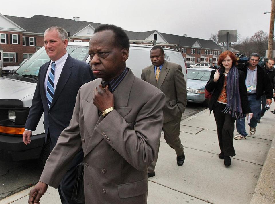 Framingham, MA 111711 Attorney Scott Bratton (cq), left, and client, Onyango Obama(cq), were trailed by media members following a pre-trial hearing at Framingham District Court, Thursday, November 17 2011. (Globe Staff Photo/Wendy Maeda) section: Metro slug: 18obamauncle reporter: Sally Jacobs