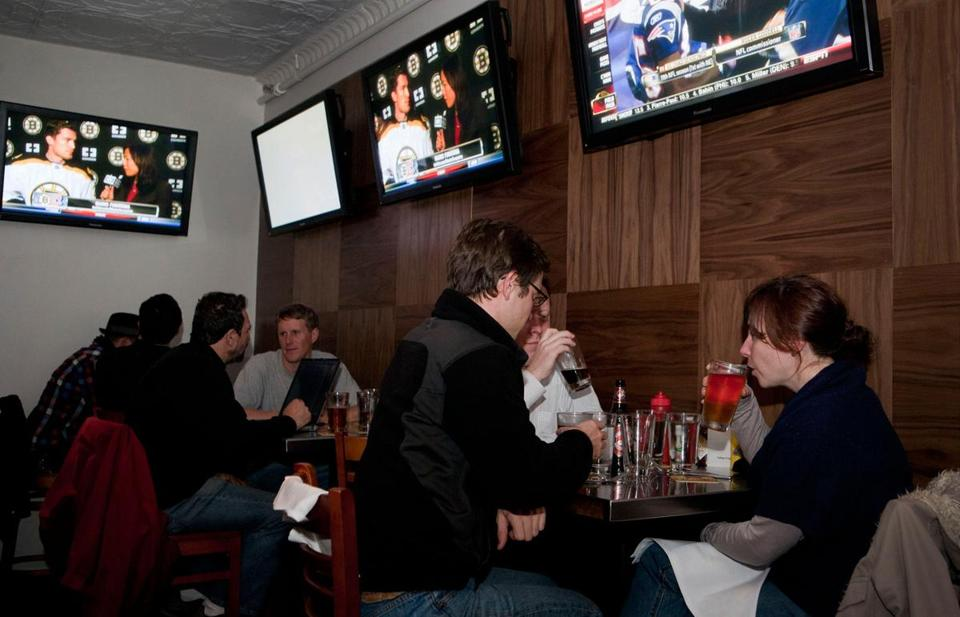 Customers at the Parlor Sports bar in Somerville, MA.