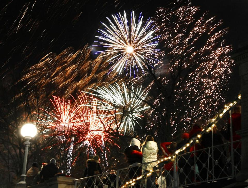 FOR METRO. Boston, MA 12/31/2010 Fireworks are seen from the Public Garden Pond, with the bridge in the foreground, on New Year's Eve for the First Night celebration in Boston, MA on Friday, December 31, 2010. (Yoon S. Byun/Globe Staff) Section: METRO Slug: n/a Reporter: n/a Library Tag 01012011 National/Foreign 25newyears