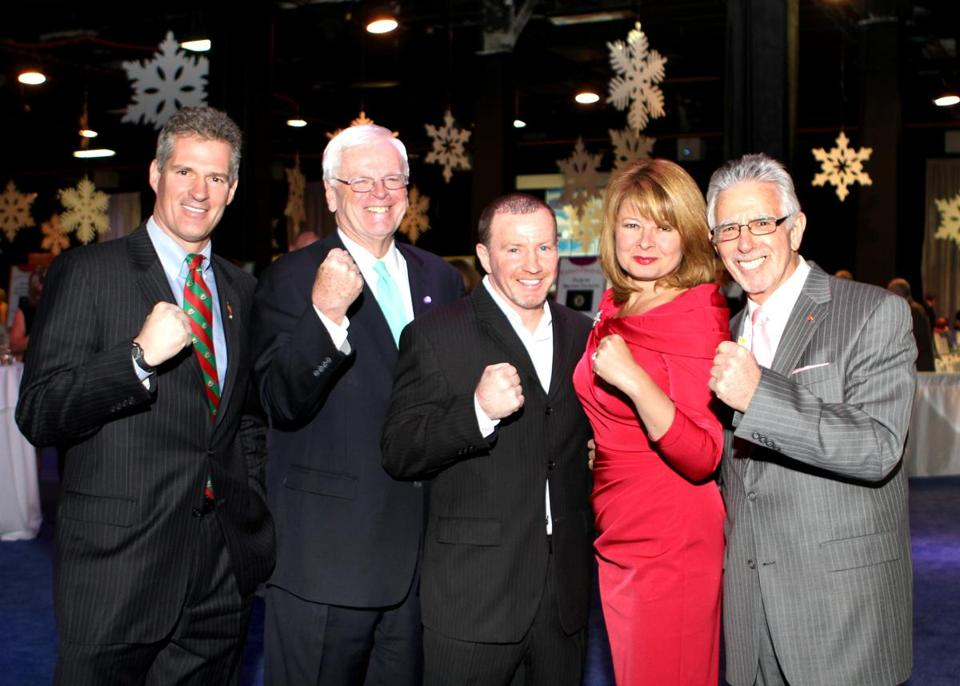 Mickey Ward (center) posed with Scott Brown and Brown's wife, Gail Huff, at an event last year.