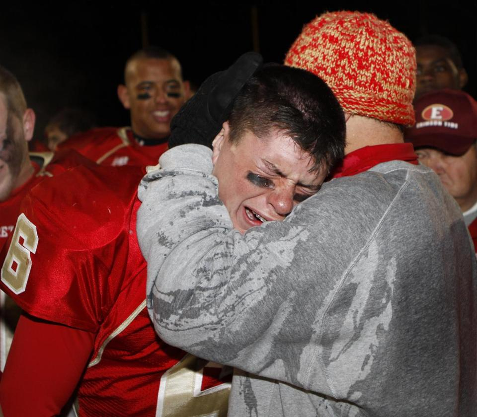 Quarterback Jonathan DiBiaso found comfort in his father/head coach after Everett won the Division 1A Super Bowl.
