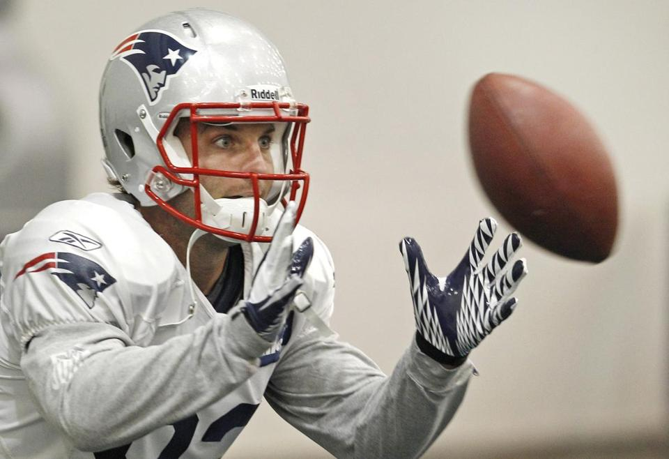 New England Patriots wide receiver Wes Welker (83) keeps his eyes on the ball on a catch during NFL football practice in Foxborough, Mass., Wednesday Dec. 7, 2011. (AP Photo/Charles Krupa)
