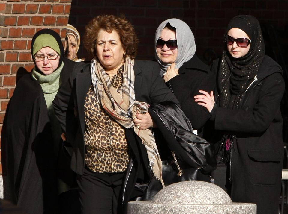 Souad Mehanna, second from right, left court after her son, Tarek Mehanna, was found guilty on terror related charges.