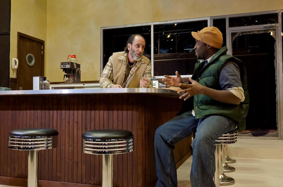 "Will LeBow (left) plays the shop owner and Omar Robinson plays his employee in ""Superior Donuts.''"
