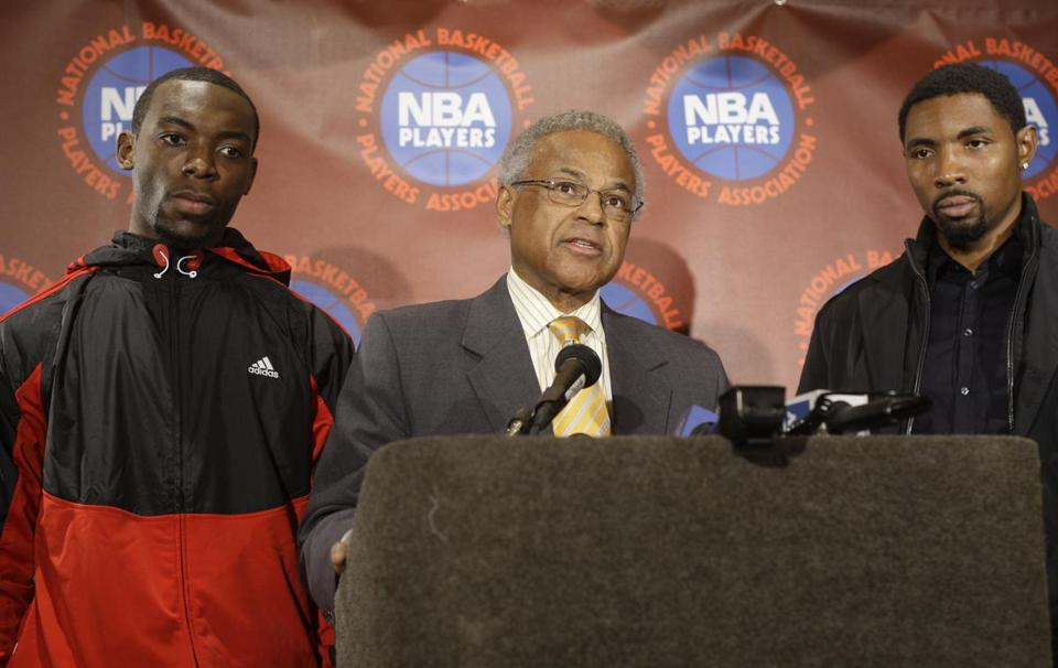 Union chief Billy Hunter, center, led the NBA players through a tumultuous labor conflict this year.