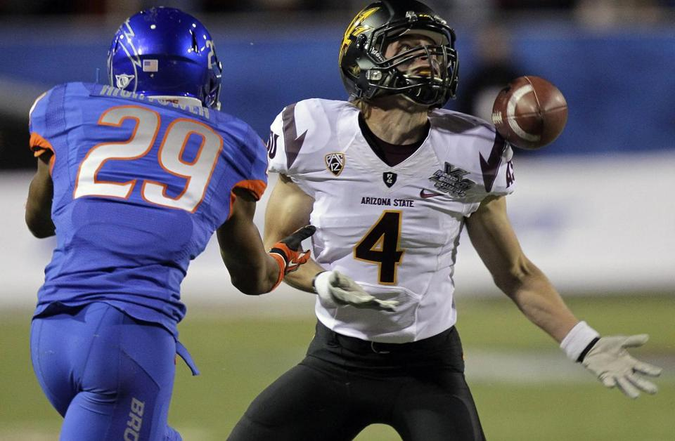 Boise State cornerback Lee Hightower (left) breaks up a pass intended for Arizona State receiver Aaron Pflugrad.