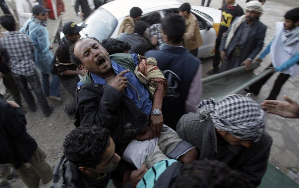 Protesters carried an injured man yesterday from the site of clashes with security forces in Sana, Yemen. When protesters entered Yemen's capital, elite troops loyal to the outgoing president opened fire with guns, water cannons, and tear gas.