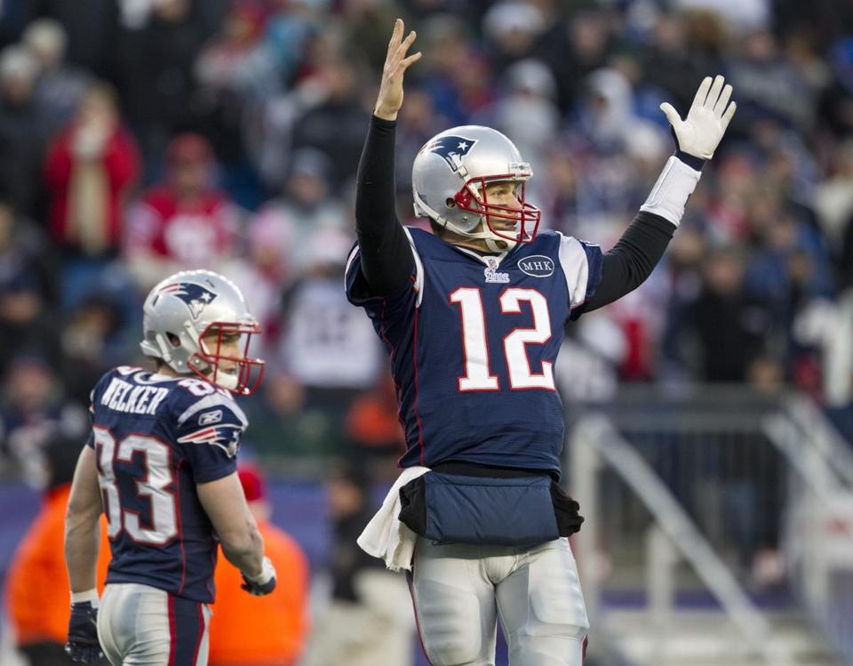 12/24/2011 Foxborough, MA New England Patriots quarterback Tom Brady signals to the bench how much yardage they need for a touchdown against the Miami Dolphins during 4th quarter action at Gillette Stadium on Sunday December 24, 2011. (Matthew J. Lee/Globe staff) slug: 25patriots section: sports Reporter: