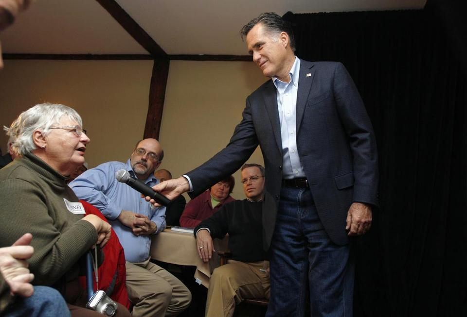 Republican presidential candidate, former Massachsetts Gov. Mitt Romney holds the microphone as a woman asks him a question during a campaigns stop at a Londonderry, N.H. restaurant, Tuesday Dec. 27, 2011. (AP Photo/Charles Krupa)