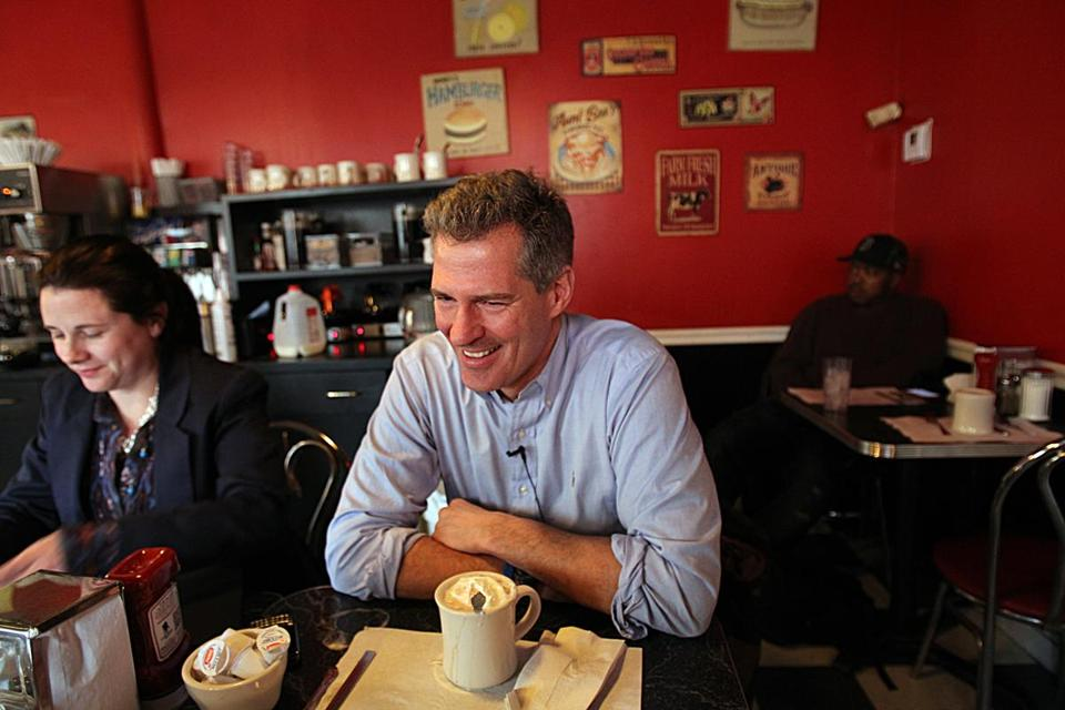 South Boston, MA., 12/28/11, Senator Scott Brown, cq, met with Boston Globe reporter Frank Philips at Mul's Diner for a chat. On the left is Marcie Ridgway Kinzel, cq, Communications Director. Section; Metro Suzanne Kreiter/Globe staff