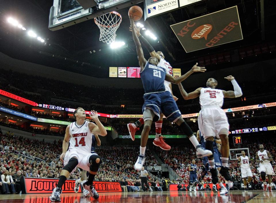 LOUISVILLE, KY - DECEMBER 28: Jason Clark #21 of the Georgetown Hoyas shoots the ball during the Big East conference game against the Louisville Cardinals at KFC YUM! Center on December 28, 2011 in Louisville, Kentucky. (Photo by Andy Lyons/Getty Images)