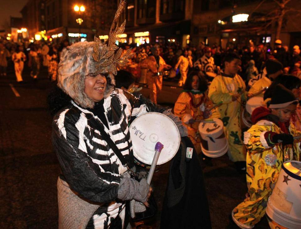 First Night celebrations continued tonight with several events, including this parade on Boylston St.