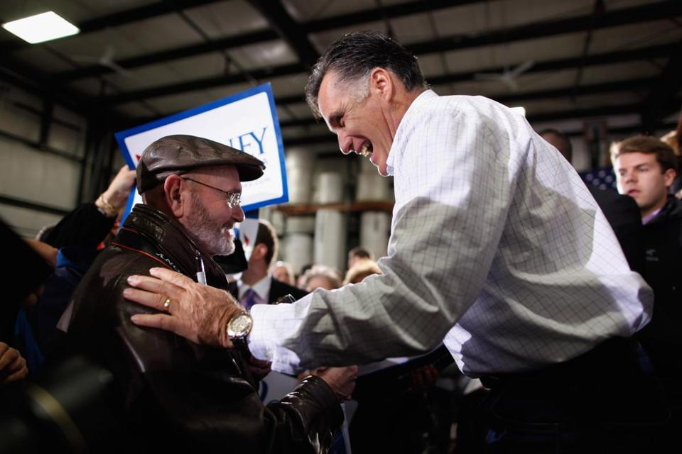 Mitt Romney greeted supporters yesterday during a rally at the Weber Paper Co. in Dubuque, Iowa. Romney said he is the candidate who can end worries over the economy.