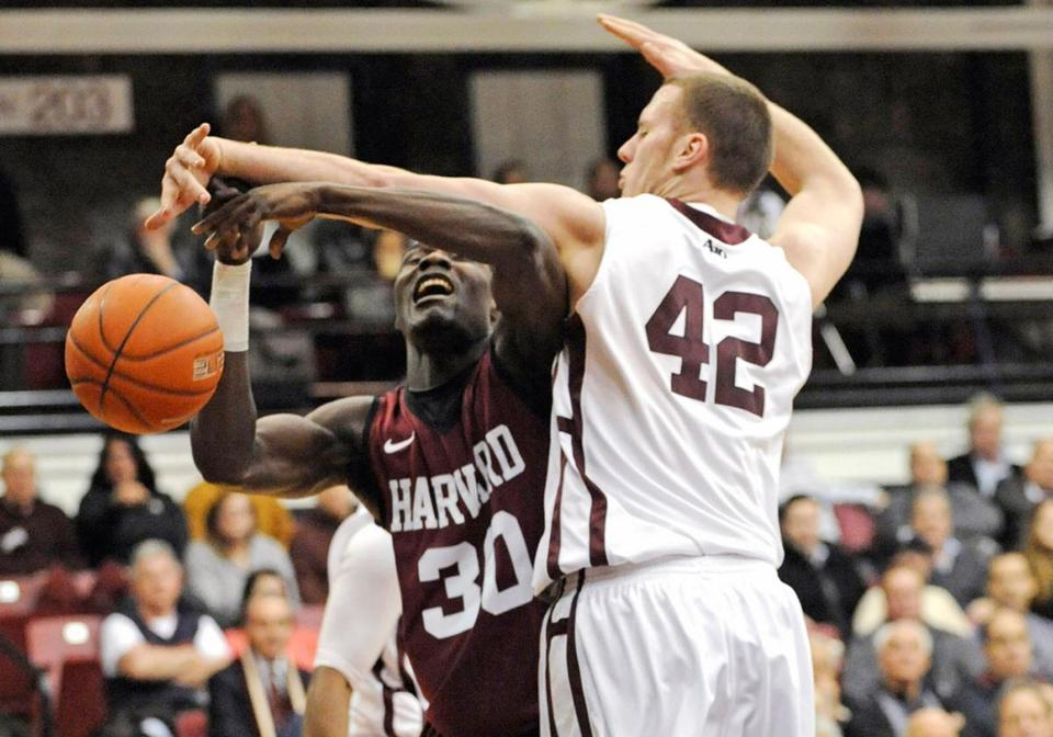 Ryan Canty (right) gets the ball — and some arm — while stuffing Kyle Casey during Fordham's upset of the No. 22 Crimson.