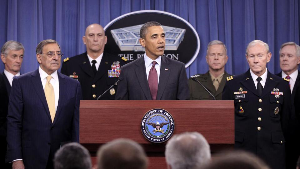 President Barack Obama speaks at the Pentagon, Thursday, Jan. 5, 2012, on the defense strategic guidance. From left are, Army Secretary John McHugh, Defense Secretary Leon Panetta, Army Chief of Staff Gen. Raymond T. Odierno, the president, Marine Corps Commandant Gen. James F. Amos, Joint Chiefs Chairman Gen. Martin E. Dempsey and Navy Secretary Ray Mabus. (AP Photo/Pablo Martinez Monsivais)
